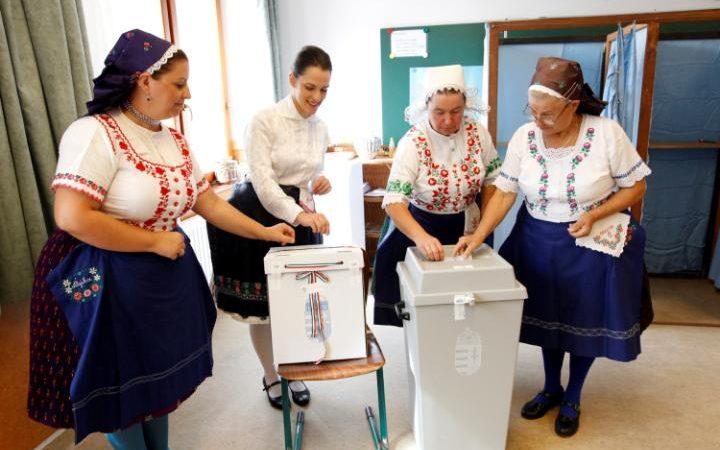 110182175_hungarian_women_wearing_traditional_costumes_attend_a_referendum_on_eu_migrant_quotas-large_transzgekzx3m936n5bqk4va8rtgju7qtstfrd21mzxayo54