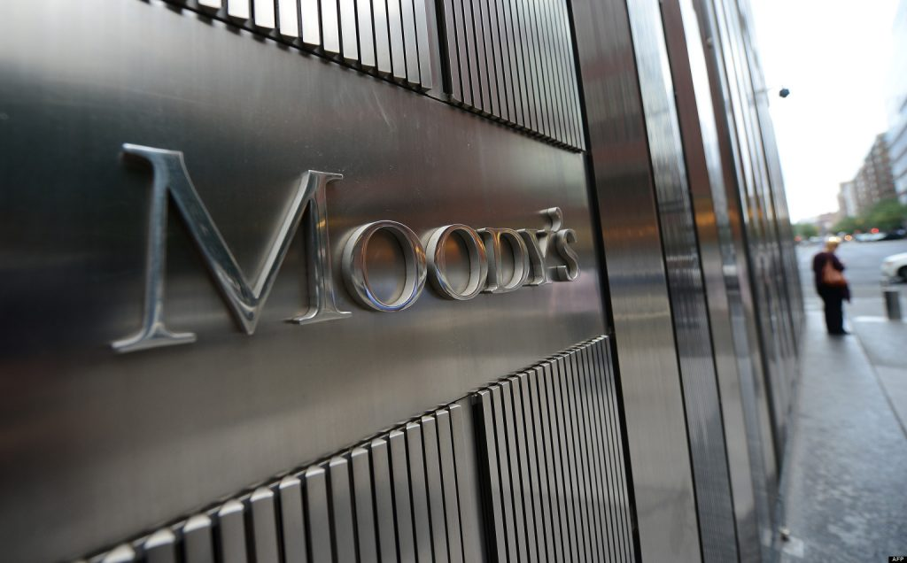 A sign for Moody's rating agency stands in front of the company headquarters in New York, September 18, 2012.  AFP PHOTO/Emmanuel Dunand